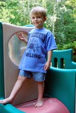 Boy in a Backyard Playground poster