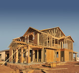 A new home being built with wood, trusses and supports poster
