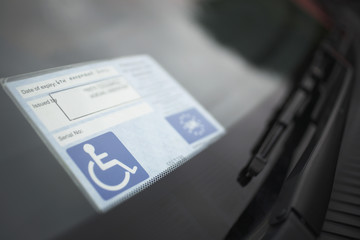 Handicap sticker on windshield