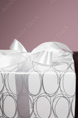 Present wrapped with silver ribbon