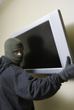 Thief stealing flat screen television