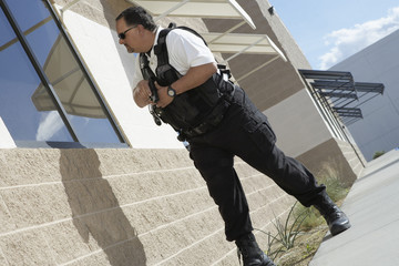 Security guard with gun patrolling