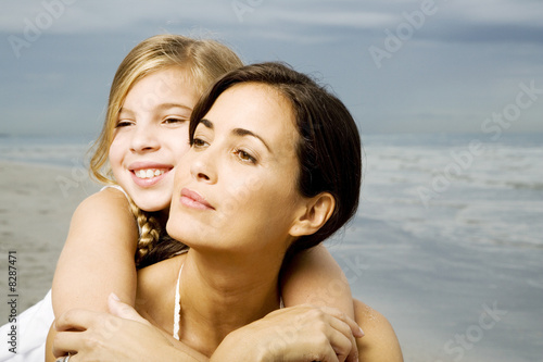 A mother and daughter on a beach