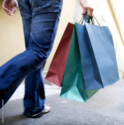 A person carrying shopping bags