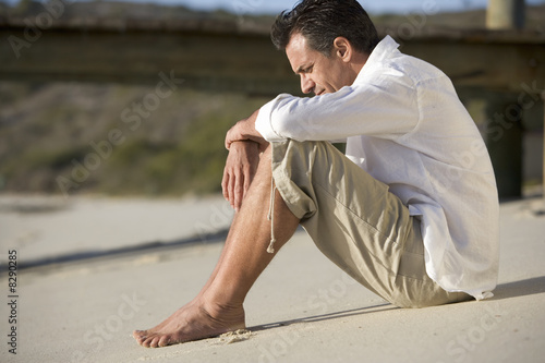 A man sitting on a beach