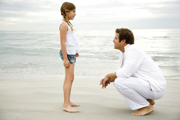 A father and daughter on a beach