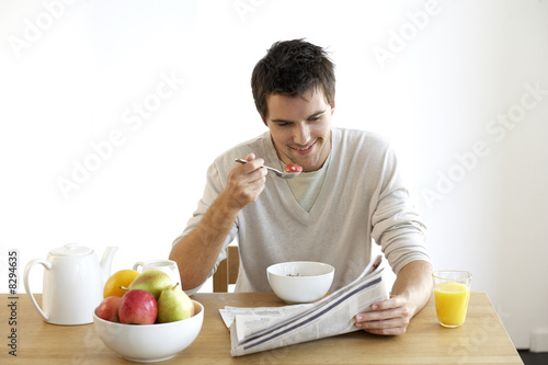 Young man having breakfast