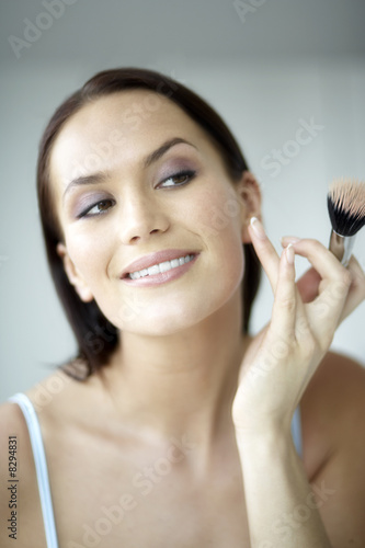 Woman applying make-up, close-up