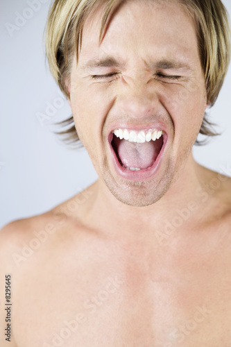 A male nude, portrait, screaming