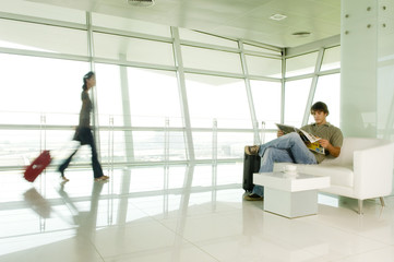 Two travellers at an airport
