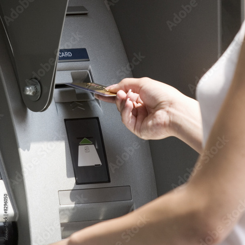 A young woman using a cash machine