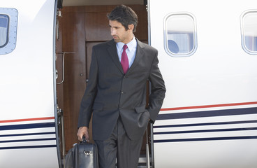 A businessman leaving a plane