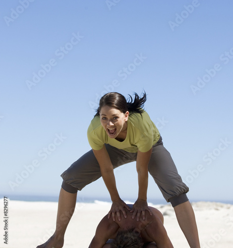 A young woman playing leap frog