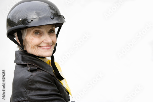 A senior woman wearing a helmet