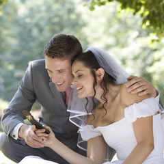 A bride and groom using a mobile phone