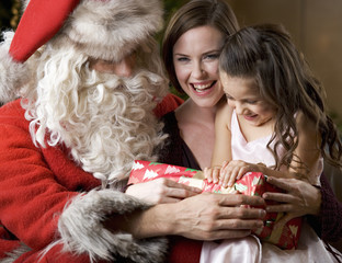 Father Christmas/Santa Claus with a mother and daughter