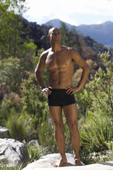 Young athletic man standing in a natural setting