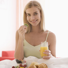 A woman having breakfast in bed