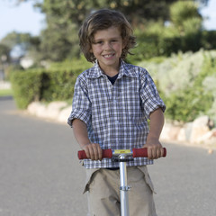 A young boy on a scooter