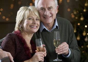 A senior couple drinking champagne