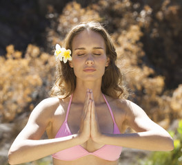 Young woman in a bikini practicing yoga