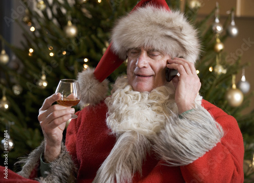 Father Christmas/Santa Claus relaxing after a hard days work