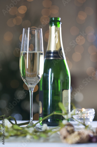 A glass of champagne and mistletoe