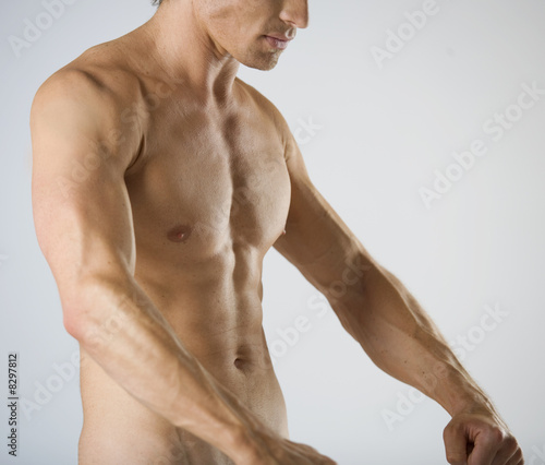 A male nude, flexing his muscles