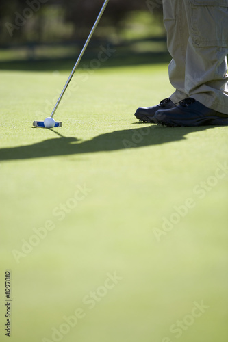 Man playing golf, close-up