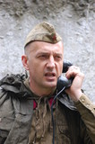Russian soldier with phone. WW2 reenacting poster