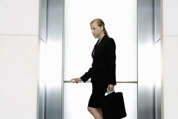 A businesswoman standing in a lift