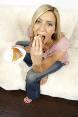 Young woman eating cake
