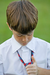 Little Boy Adjusting His Tie
