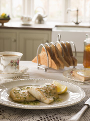 Smoked Haddock with Herb Butter on breakfast table