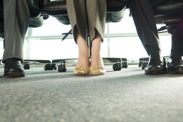 Feet under a desk