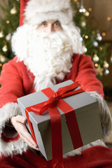 Father Christmas/Santa Claus holding a present