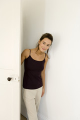 A young woman entering a room