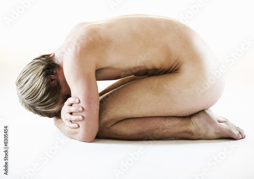 A male nude, kneeling