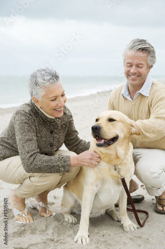 A senior couple walking their dog