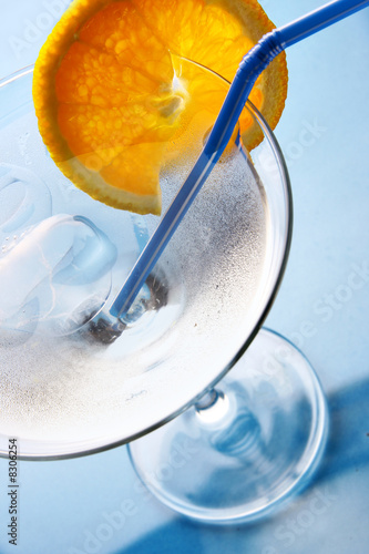 Glass of cocktail with ice and orange slice