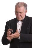older businessman impersonating James Bond poster