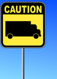 yellow caution sign with transport truck against blue sky  poster