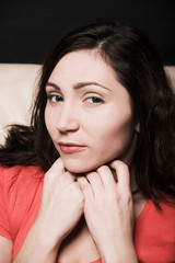 Beautiful woman relaxing on a white sofa