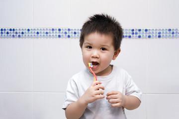 Little boy brushing his teeth