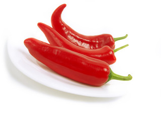 Tasty red peppers on white plate