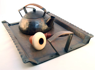 Tea Pot And Pipe On A Vintage antique Tray