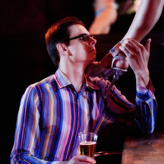 A man tipping an erotic dancer