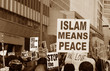 Постер, плакат: Muslim Protest And Protestors With Sign islam means peace