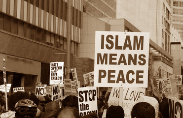 Muslim Protest And Protestors With Sign islam means peace