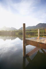 South Africa, jetty beside tranquil lake in bright sunlight, side view (lens flare)